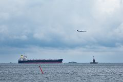 Lighthouse, vessel and airplane near Copenhagen, Denmark Stock Photography
