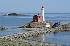 Lighthouse in victoria bc. Historic fisgard lighthouse at seashore, it is the first lighthouse built in vancouver island in 1860, victoria, british columbia Royalty Free Stock Images