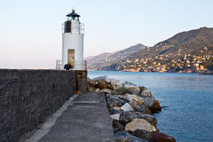 Lighthouse in the Village of Camogli Royalty Free Stock Images