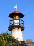 Lighthouse in the village of pirates Stock Images