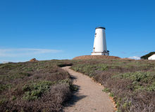Lighthouse and walking path at Piedras Blancas point on the Central Coast of California Royalty Free Stock Image