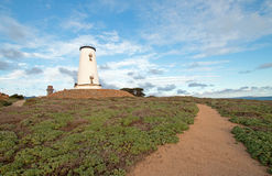 Lighthouse and walking path at Piedras Blancas point on the Central Coast of California Royalty Free Stock Photos