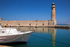 Lighthouse and wall at old Venetian harbour in Rethymno Crete Gr Royalty Free Stock Photos