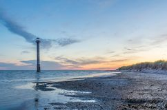 A lighthouse in warm morning light Royalty Free Stock Photos