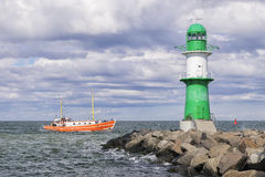 Lighthouse of Warnemunde with fishing boat Stock Photography
