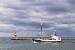 Lighthouse of Warnemunde with fishing boat Royalty Free Stock Images