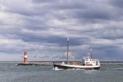 Lighthouse of Warnemunde with fishing boat Royalty Free Stock Images