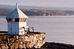 Lighthouse by water. Lighthouse with bench, Oslo Fjord, Norway Stock Photos