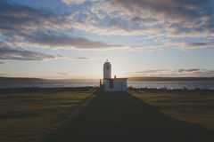 Lighthouse On The Water Stock Photography