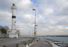 Lighthouse on the waterfront of the Bosphorus in winter. Istanbul Royalty Free Stock Photo