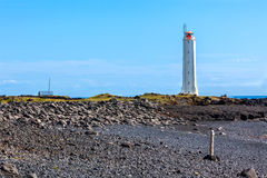 Lighthouse in West Iceland at sunny weather Stock Images