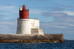 Lighthouse with White Base and Red Tower Stock Photo