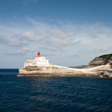 Lighthouse on a white cliff Royalty Free Stock Photos