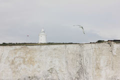 Lighthouse On White Cliffs Of Dover, UK Stock Photo
