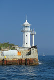 Lighthouse. White lighthouse on the pier in the city of Yalta, Republic of Crimea, Russia Royalty Free Stock Photos