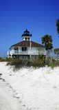 Lighthouse and white sand Stock Photos