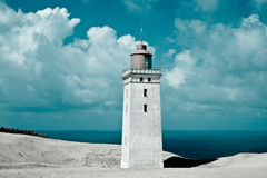 Lighthouse, white sand and sea Royalty Free Stock Images