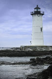 Lighthouse. White lighthouse on a shoreline Royalty Free Stock Photos