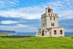 Lighthouse. White lighthouse at southern Iceland coast. Dyrholaey royalty free stock image