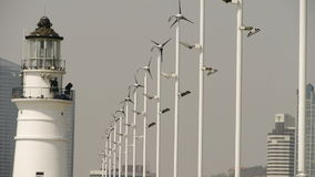 Lighthouse and wind turbine & new power energy city. stock video footage