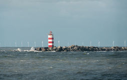 Lighthouse and Wind Turbines Royalty Free Stock Photo