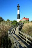 Lighthouse and Winding Boardwalk Stock Images