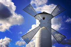 Lighthouse - windmill against the sky - Swinoujscie Stock Image