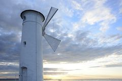 Lighthouse - windmill against the sky - Swinoujscie Stock Images