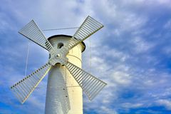 Lighthouse - windmill against the sky - Swinoujscie Royalty Free Stock Photos
