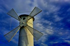 Lighthouse - windmill against the sky - Swinoujscie Royalty Free Stock Image