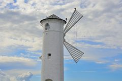 Lighthouse - windmill against the sky - Swinoujscie Stock Photo