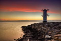 Lighthouse windmill Stawa Mlyny in Swinoujscie, Stock Photography