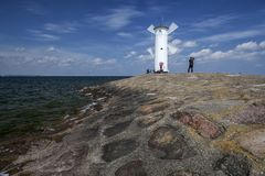 Lighthouse windmill Stawa Mlyny in Swinoujscie, Royalty Free Stock Photos