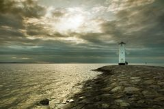 Lighthouse windmill Stawa Mlyny in Swinoujscie, Baltic Sea Royalty Free Stock Image