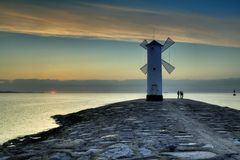 Lighthouse windmill Stawa Mlyny in Swinoujscie, Baltic Sea Stock Image