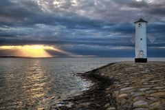 Lighthouse windmill Stawa Mlyny in Swinoujscie, Baltic Sea Stock Photo