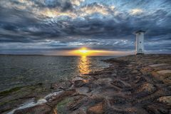 Lighthouse windmill Stawa Mlyny in Swinoujscie, Baltic Sea Royalty Free Stock Photo