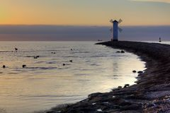 Lighthouse windmill Stawa Mlyny, Swinoujscie, Baltic Sea, Royalty Free Stock Images