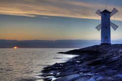 Lighthouse windmill Stawa Mlyny, Swinoujscie, Baltic Sea, Stock Images