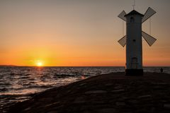 Lighthouse windmill Stawa Mlyny, Swinoujscie, Baltic Sea, Royalty Free Stock Photo