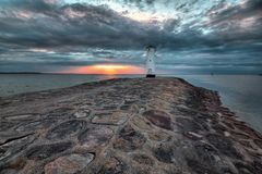 Lighthouse windmill Stawa Mlyny, Swinoujscie, Baltic Sea, Stock Image