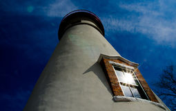 Lighthouse with sun reflecting in the window. Stock Image