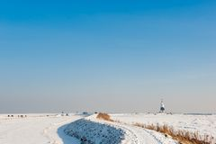 Lighthouse in winter Stock Images