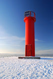 Lighthouse in winter. Lighthouse near the frozen sea in winter royalty free stock images