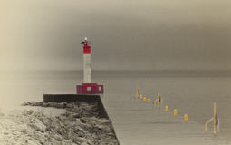 Lighthouse in the Winter Fog Royalty Free Stock Photos