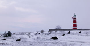 Lighthouse during winter.JH. Lighthouse on the island gotland in the balticsea in Sweden.JH royalty free stock photos