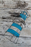 Lighthouse on wooden board Royalty Free Stock Photo