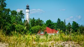 Lighthouse in the Woods Stock Image