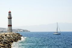 Lighthouse and Yacht Royalty Free Stock Photo
