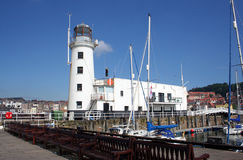 Lighthouse and yacht marina Stock Photos